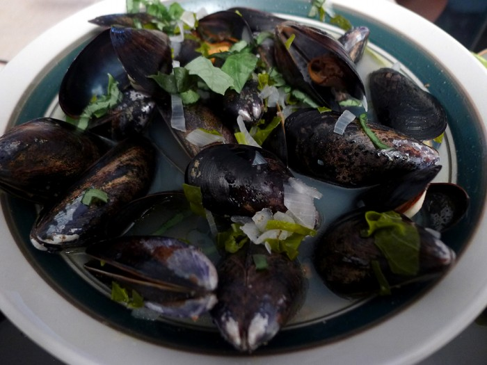 Mussels with shallots and basil in white wine sauce